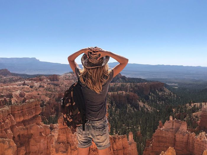 Rear view of woman looking at rock formations at bryce canyon