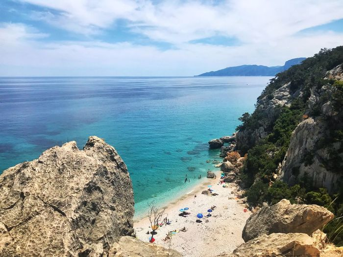 Sardegna Enlight IPhone 7 Sardegna Sea Water Beach Sky Land Beauty In Nature Scenics - Nature Horizon Over Water Tranquility Nature Rock Tranquil Scene Cloud - Sky Horizon Rock - Object Sand Day Solid Idyllic Outdoors