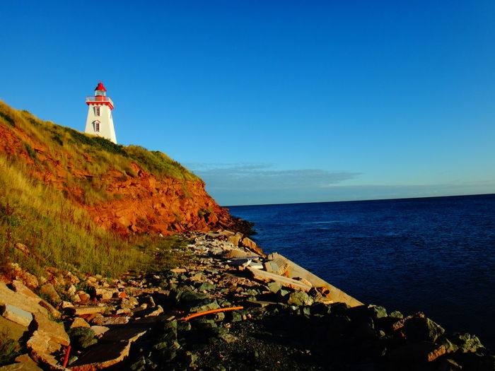 Lighthouse Architecture Beach Beauty In Nature Building Building Exterior Built Structure Canada Coast Guidance Horizon Horizon Over Water Land Lighthouse Nature No People Outdoors Pei Prince Edward Island Rock Scenics - Nature Sea Sky Tower Water