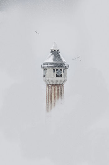 winter feeling Architecture Built Structure Building Exterior Cold Temperature Snow Winter Fog Tower Spirituality Building Tranquil Scene Minimalist Architecture Minimalism Bird Photography EyeEm Best Shots EyEmNewHere Factory Building Misty Foggy Morning Clock Tower Graphisoftpark Alone In The City  Old Buildings Freedom My Best Photo