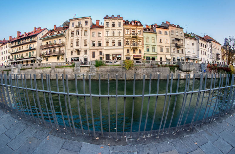 Ljubljana through fisheye Building Exterior Architecture Built Structure City Water Building Residential District Nature Clear Sky Day Sky Travel Destinations No People Transportation Outdoors Mode Of Transportation Old Street House Canal Ljubljana Europe Slovenia EyeEm City Shots