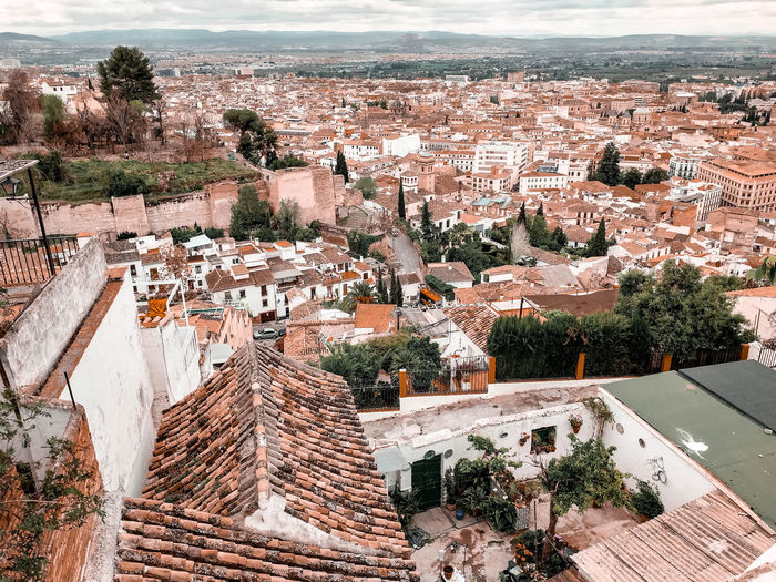 a view of Granada Mediterranean  SPAIN Andalucía Looking Down Mountains Cityscape City Tiled Roof  Red Tiles Orange Color Old Town Europe European