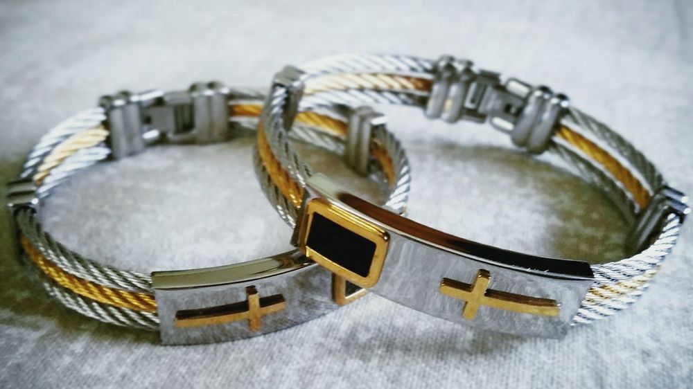 Lieblingsteil Close-up BraceletJewelry Gold Gold Colored Stainless Steel  Cross Religious  Accessory Accessories, Aroma, Aromatherapy, Background, Bag, Box, Case, Celebration, Chinese, Clean, Color, Container, Cosmetic, Cotton, Cut, Cutout, Decoration, Decorative, Design, Dry, Embroidery, Fabric, Flower, Fragrant, Gift, Grooming, Handmade, Holder, Holida No People Product Product Photography Productphotography Close Up Photography Decoration Bracelet & Necklace Bracelet Buddies Bracelets&Watches Bracelet ❤️ Decorated