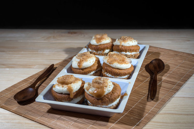 Fresh Banana Nut Muffins on a serving plate Banana Nuts Spoon Bananas Close-up Food Food And Drink Freshness Indoors  Indulgence Muffin Muffins No People Plate Ready-to-eat Sweet Food Table Temptation Wood - Material