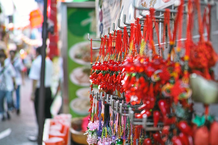 Close-Up Of Craft Products Hanging At Market Stall