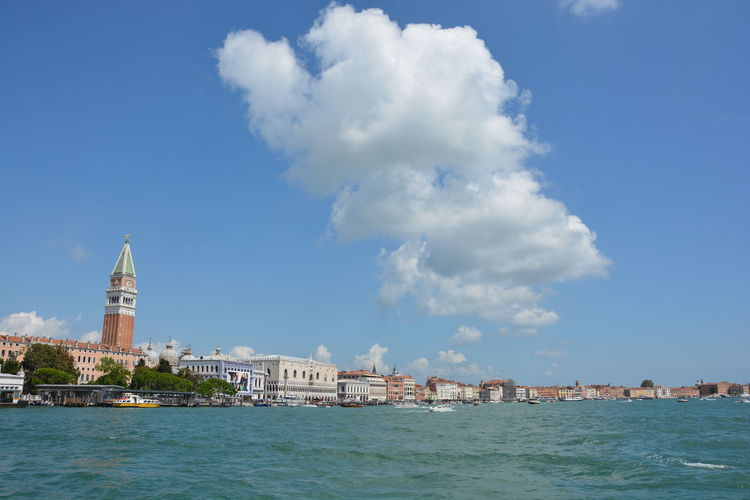 Grand canal by buildings against sky