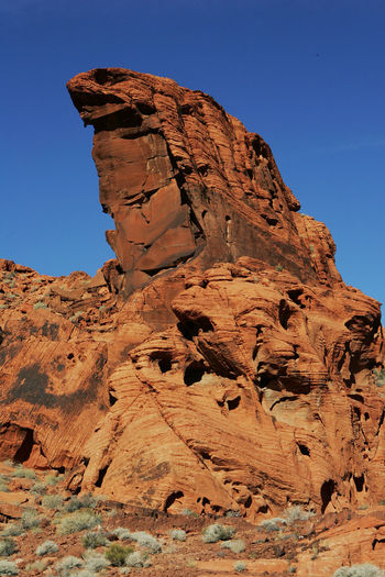 Rock formation at valley of fire state park against clear blue sky