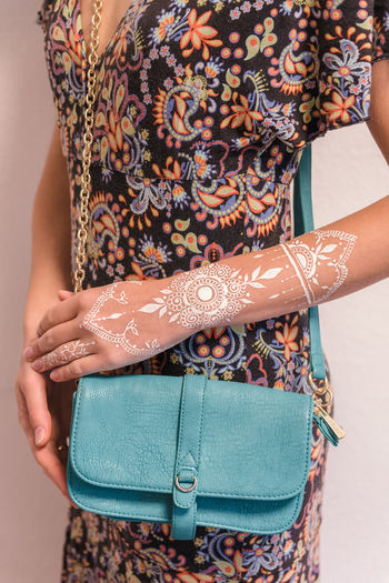 Midsection One Person Women Adult Pattern Lifestyles Real People Indoors  Standing Floral Pattern Human Body Part Clothing Front View Casual Clothing Close-up Fashion Human Abdomen Young Women Hand Womenswear Henna Tattoo