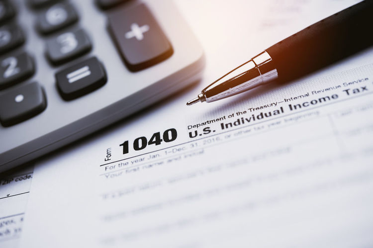 Calculator Pen Selective Focus Close-up Paper Finance Number Business Still Life Writing Instrument No People Text Document Table Indoors  Financial Figures Western Script Communication Mathematics Budget Paperwork Calculating Keypad