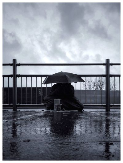 Water Rain Weather Rainy Season Wet Sky One Person Real People Cloud - Sky Protection Outdoors Rear View Below River Day Men Under Full Length Architecture Nature Homeless Blackandwhite Whiteborder Postcode Postcards Black And White Friday