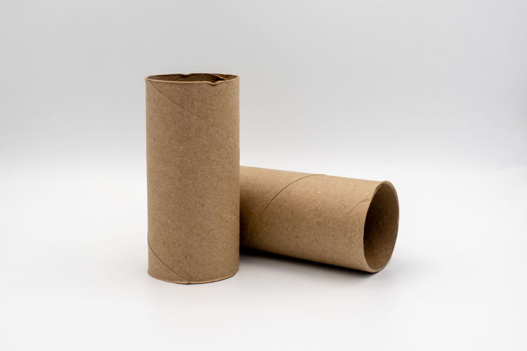 Brown Business Close-up Container Copy Space Creativity Cut Out Indoors  No People Paper Rolled Up Simplicity Single Object Solution Studio Shot The Core Toilet Paper Two Objects White Background