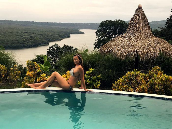 Relaxing Bikini One Person Swimming Pool Leisure Activity Relaxation Vacations Beauty In Nature Full Length Nature Tree Day Tranquility Lifestyles Lying Down Women Nicaragua Masaya Scenics Cloud - Sky Lagoon Lake Lagoon Water Jungle