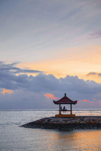 Beautiful Scenery at Karang Beach, Sanur, Bali, Indonesia Bali Nature Poster Architecture Banner Beach Beauty In Nature Built Structure Cloud - Sky Gazebo Horizon Horizon Over Water Landscape Nature No People Orange Color Outdoors Scenics - Nature Sea Silhouette Sky Sunset Tranquil Scene Tranquility Water