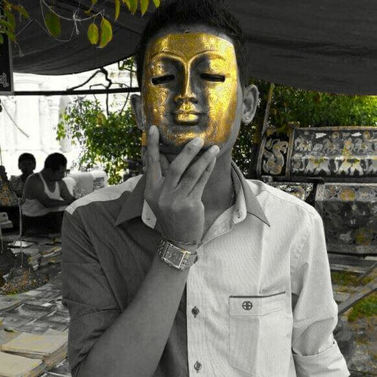 Man with gold mask....