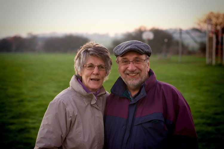 Portrait of a smiling couple on a field