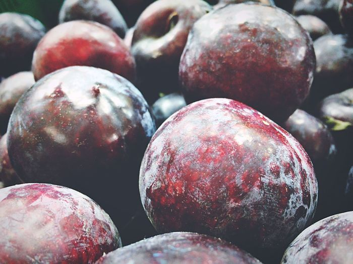 Close-up of plums at market for sale