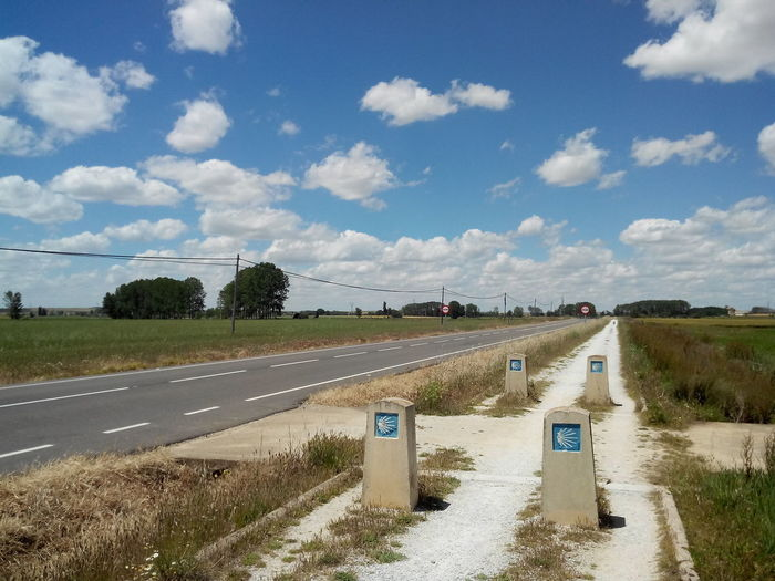 Road By Field Against Sky