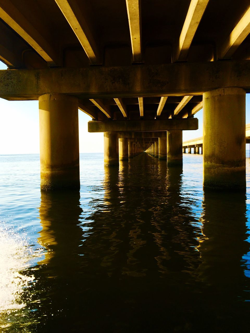 bridge - man made structure, connection, underneath, below, river, engineering, architecture, water, built structure, architectural column, bridge, strength, outdoors, under, no people, nature, day