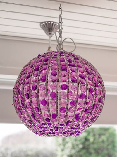 Lamp with Violet glass diamonds hanging on the ceiling Violet Lamp Interiors Hanging Indoors  Purple Close-up No People Ceiling Decoration Art And Craft Sphere Craft Lighting Equipment Home Interior Single Object Design Pattern Focus On Foreground Day Still Life Shape Pink Color