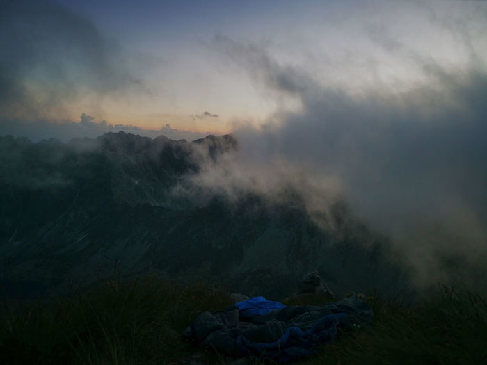 Fog over the mountain valley illuminated by the sunset. tatra mountains slovakia.