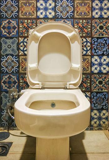View of toilet bowl in bathroom