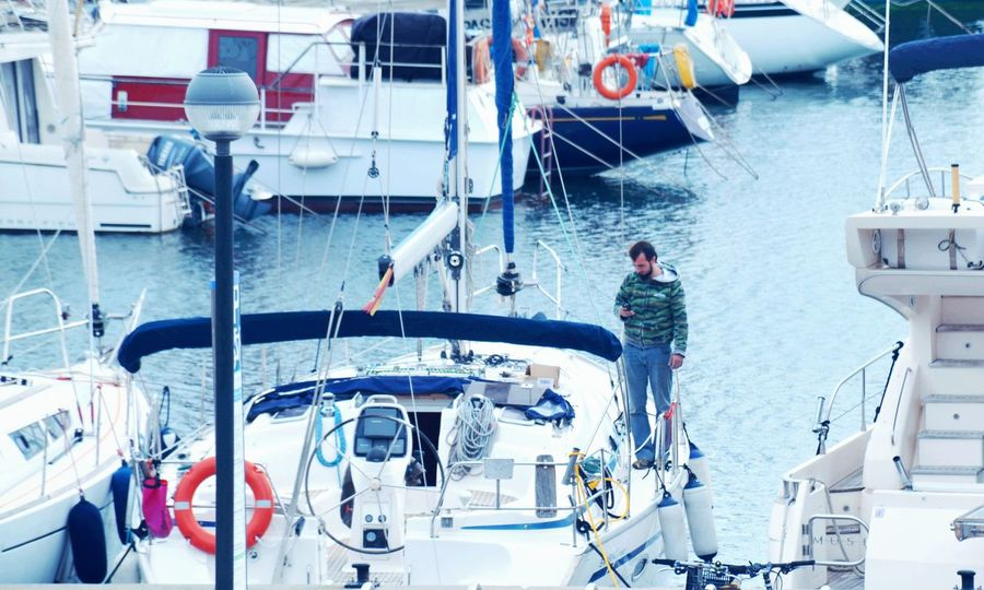 Communication on board Nautical Vessel Transportation Men Mode Of Transport Sea Water Boat Deck Sailing Ship Adults Only Only Men Sailing Sailor Outdoors People One Person Crew Day Adult Yacht One Man Only Mobile Conversations EyeEmNewHere Long Goodbye