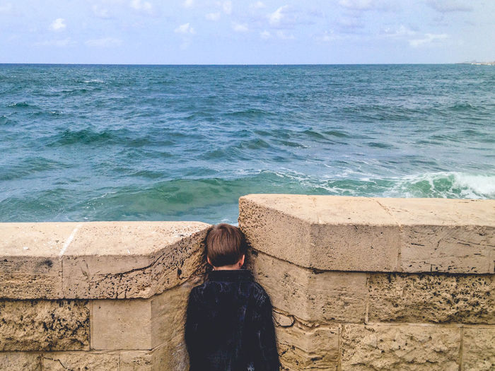 Alone Alone Time Blue Gap Kid Looking Looking Into The Future Looking To The Other Side Man Ocean Ocean View Sea Sea And Sky Sea View Searching Wall Wall - Building Feature Water Waves Waves, Ocean, Nature