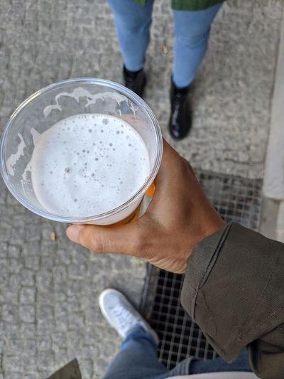 Low section of man holding drink