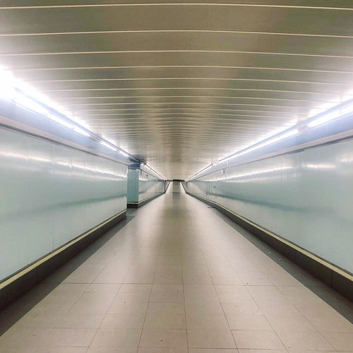 Futuristic The Way Forward Direction Architecture Diminishing Perspective Illuminated Indoors  Ceiling Tunnel Transportation No People Public Transportation Empty Footpath Built Structure Lighting Equipment vanishing point First Eyeem Photo
