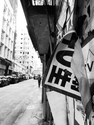 Building Exterior City Street Outdoors Built Structure City Day Sai Ying Pun Hong Kong Hong Kong Street Hong Kong Island Hongkonglife Black And White Photography Streetphotography Streetphotography_bw Signs Leaflets Welcome To Black Black And White Friday
