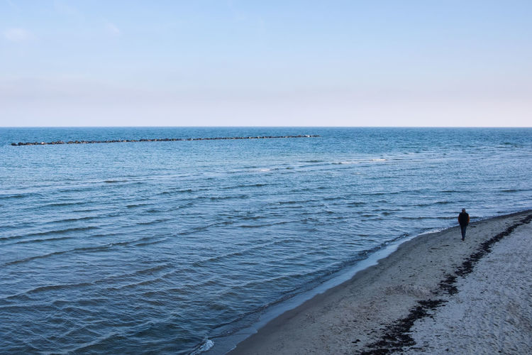 Sea Sky Water Horizon Over Water Horizon Scenics - Nature Beauty In Nature Land Beach Tranquil Scene Tranquility Nature Idyllic Day Real People Men Leisure Activity Outdoors One Person