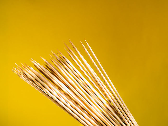 Thin bamboo skewers for grill on a yellow background. Kitchen accessories for cooking kebab and barbecue, front view Studio Shot Yellow Colored Background Food And Drink Food Close-up No People Copy Space Still Life Bamboo - Material Stick Grill Skewer Accessory Kitchen Kitchen Utensil Sharp Things I Like Group Of Objects