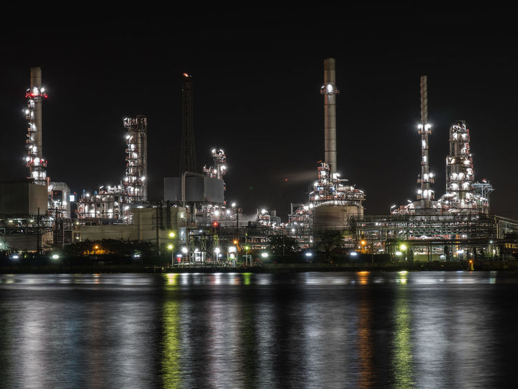 Architecture Building Exterior Built Structure Factory Illuminated Industry Night No People Oil Industry Oil Refinery Outdoors Petrochemical Plant Refinery Sky Smoke Stack Water Waterfront