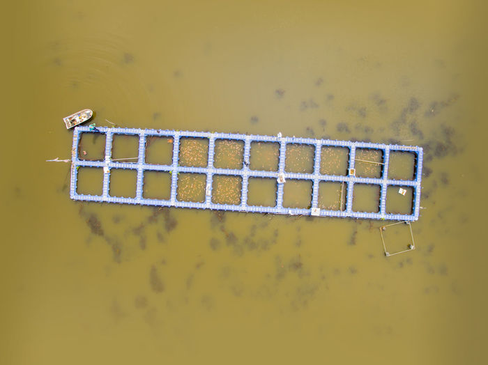 Aerial view of traditional fishing cage in river