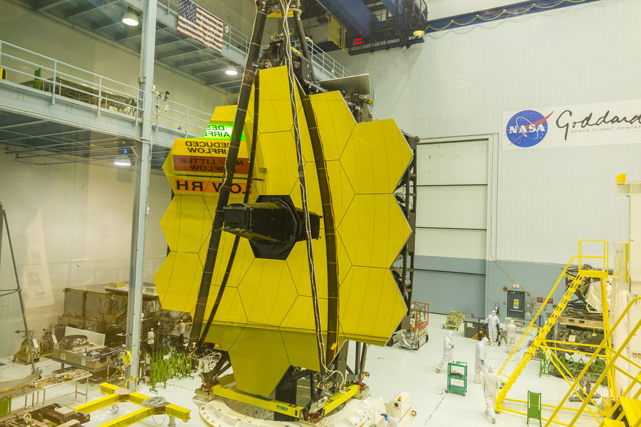 The Goddard Space Flight Center clean room is reflected in the gold-coated primary mirror segments of the James Webb Space Telescope after it was raised to the vertical position Engineering Goddard Space Flight Center Gold GSFC James Webb Space Telescope JWST NASA Satellite Science Space Spacecraft Telescope