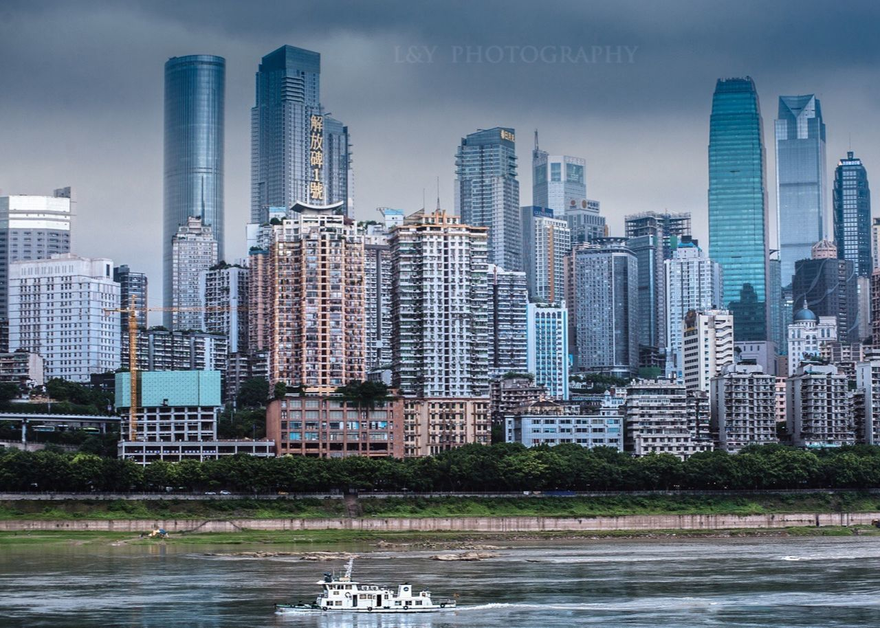skyscraper, architecture, building exterior, water, city, tower, built structure, cityscape, urban skyline, waterfront, river, no people, downtown district, modern, outdoors, day, sky