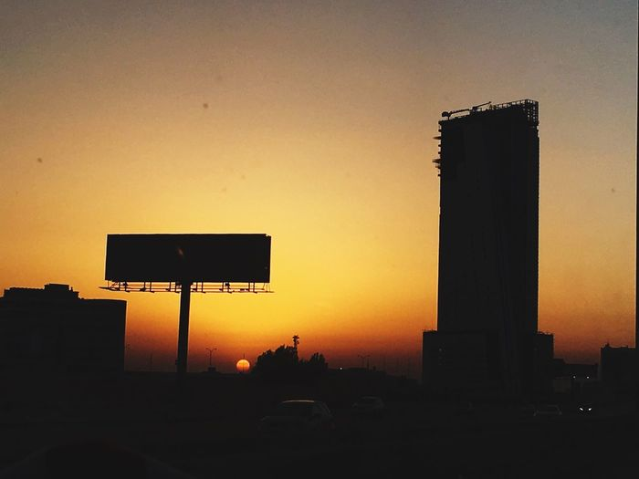 Time to set Sunset Architecture Dusk City Sky Outdoors Clear Sky Cityscape Building Exterior Travel Destinations No People Golden Hour