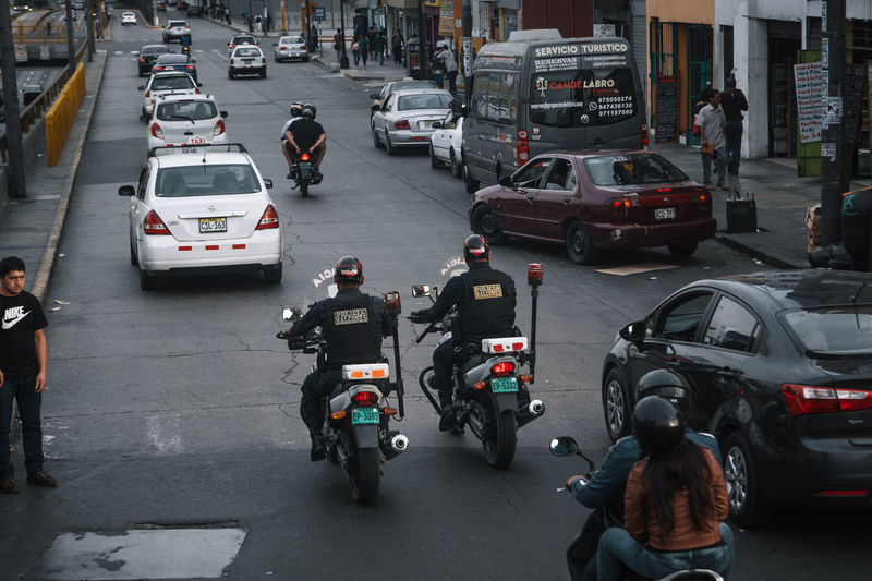 The streets of Peru's capital. Transportation Mode Of Transportation Land Vehicle Street Travel Travel Destinations Motor Vehicle Motorcycle Urban City City Life Car Road Traffic Real People Architecture Group Of People Men People City Street Incidental People Riding Police Built Structure Building Exterior