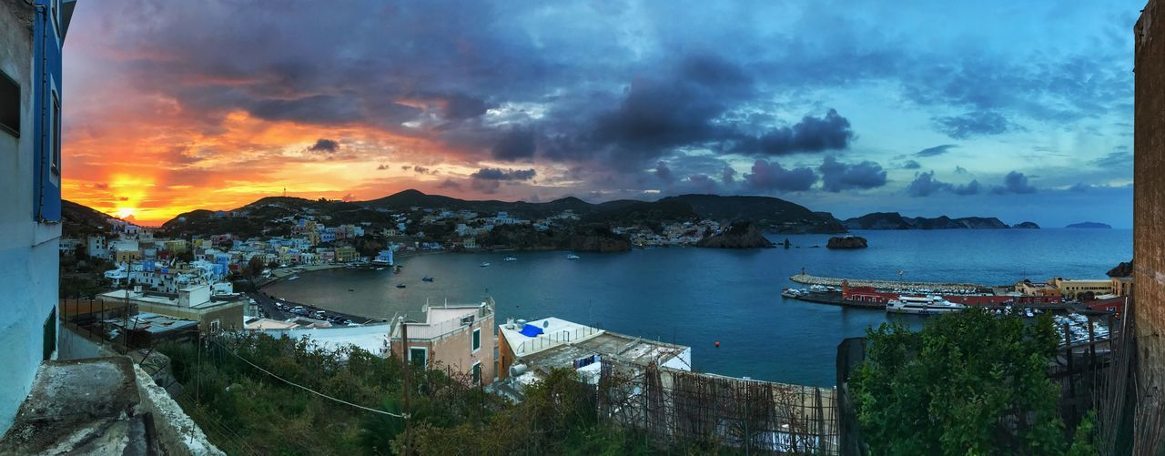 All island on golden hour Ponza Italy Island Sea Sky Water Cloud - Sky Sea Nature Architecture Scenics - Nature Transportation Building Exterior Nautical Vessel Built Structure Beauty In Nature City Sunset No People Mountain Mode Of Transportation High Angle View Beach Outdoors