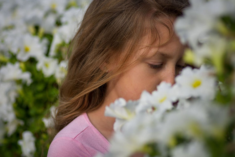 Backgrounds Beauty In Nature Child Childhood Close-up Flower Flowering Plant Fragility Hairstyle Headshot Innocence Leisure Activity One Person Plant Portrait Real People Selective Focus This Is My Skin The Portraitist - 2018 EyeEm Awards A New Beginning Human Connection
