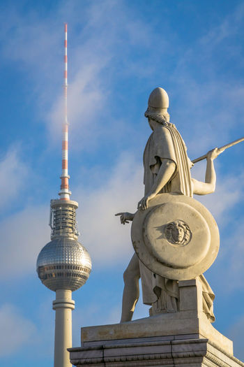 Spire  Tall - High Male Likeness Tower Tourism No People Day Travel Representation City Statue Building Exterior Human Representation Cloud - Sky Art And Craft Sculpture Travel Destinations Built Structure Architecture Berlin Alexanderplatz Finger Point Of View Point And Shoot Tv Tower Berlin