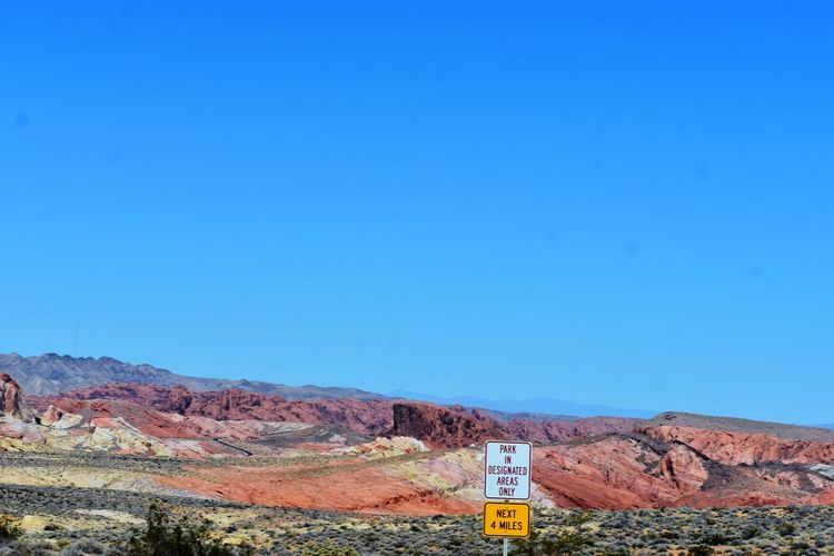 Valley Of Fire State Park Beauty In Nature Blue Clear Sky Copy Space Environment Landscape Outdoors Scenics - Nature Sign