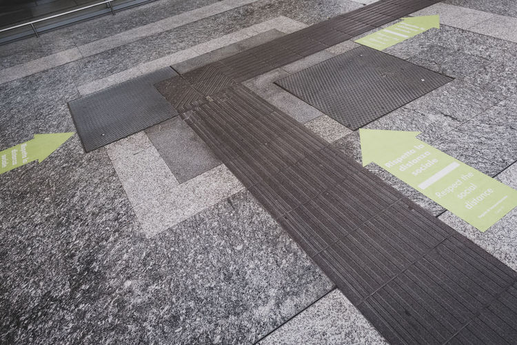 High angle view of zebra crossing on street in city