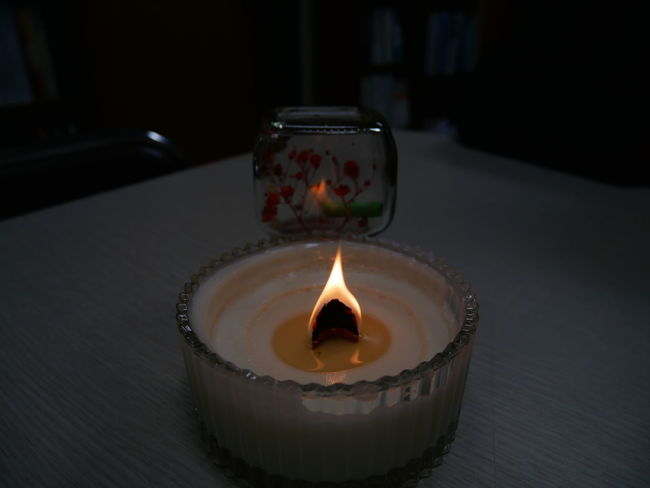 Burning Candle Close-up Day Diya - Oil Lamp Flame Glowing Heat - Temperature Illuminated Indoors  No People Oil Lamp Table Tea Light