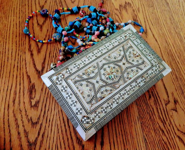 Jewellry Box and necklaces on a table Egyptian Box Accessories Ethnic Beads African Asian  Arab Wooden Table Wood Grain Box Mother Of Pearl Decorative Design Necklaces Necklaces Coming Out Of Box Colourful Necklaces Beads Handicrafts Beads-necklace Handmade ArtWork