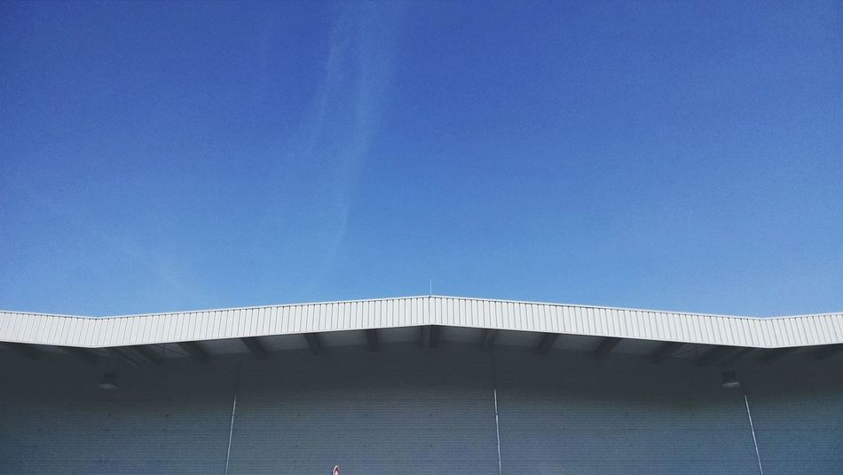 Hangar. Urban Landscape Blue Sky Urban Exploring Infrastructure Industrial Architecture South Blue Wave The Architect - 2015 EyeEm Awards Roof Amazing Architecture From My Doorstep Minimalist Architecture