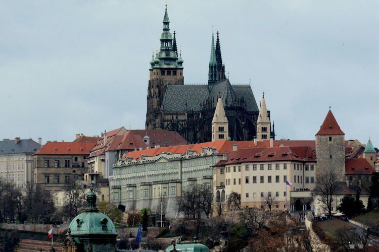 Low Angle View Of St Vitus Cathedral And Buildings Against Sky