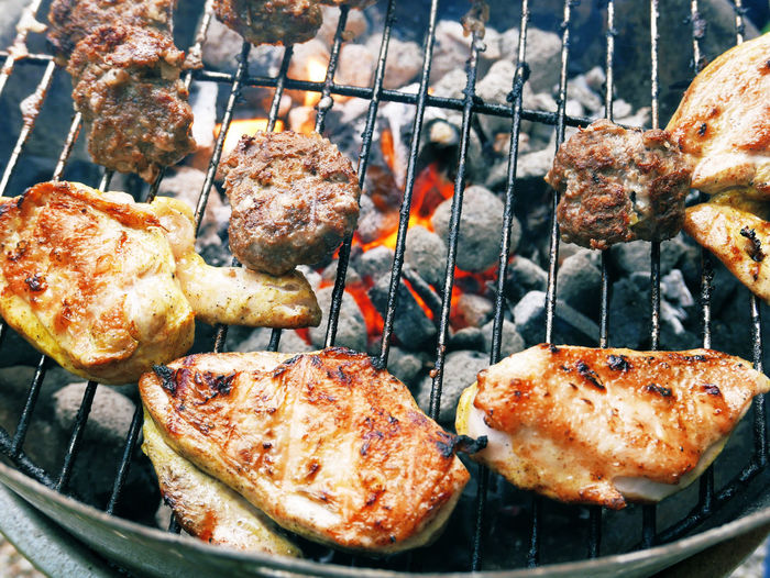 Close-Up Of Meat Being Cooked On Barbeque Grill
