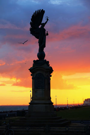 Brighton Beach Brighton And Hove Architecture Art And Craft Brighton Uk Building Exterior Built Structure Cloud - Sky Creativity History Human Representation Low Angle View Nature No People Orange Color Outdoors Peace Statue Representation Sculpture Silhouette Sky Statue Sunset Travel Destinations