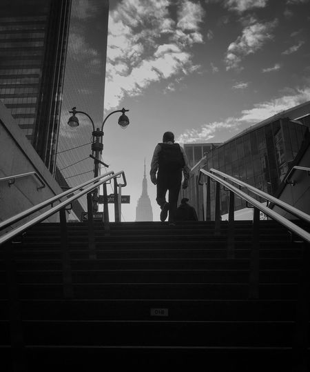 Low angle view of man walking on stairs